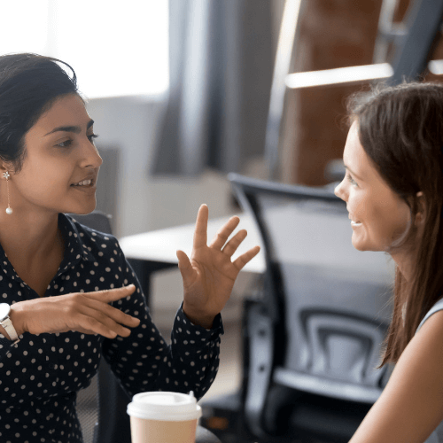 Two female colleagues in conversation